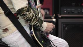 Guitarist playing electric guitar stock video