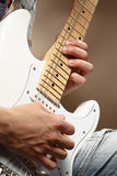 Guitarist playing an electric guitar Stock Image