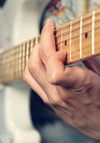 Guitarist playing an electric guitar Royalty Free Stock Images