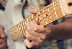 Guitarist playing an electric guitar Royalty Free Stock Image