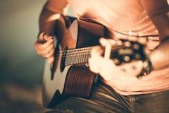 Guitarist Playing Guitar. Caucasian Guitarist Playing Acoustic Guitar. Closeup Music String Instrument Theme stock image