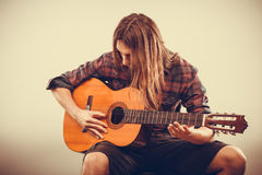 Guitarist is playing the guitar. Royalty Free Stock Image