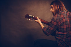 Guitarist is playing the guitar. Stock Photography