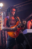 Guitarist playing guitar on stage. In nightclub Royalty Free Stock Photo