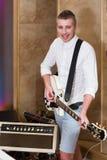 Guitarist playing guitar in the studio Stock Photos