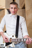 Guitarist playing guitar Stock Images