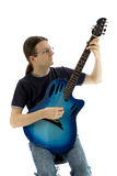 Guitarist playing his electroacoustic guitar, vertical. Guitarist with a blue guitar on a white background Royalty Free Stock Photography