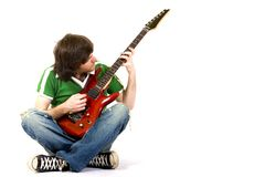 Guitarist playing his guitar. Guitarist playing his electric guitar deated Stock Images