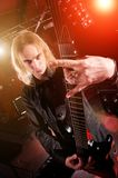 Guitarist is playing and making a rock hand gest Stock Image