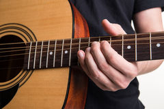 The guitarist plays the acoustic guitar close-up. Horizontal frame Stock Photo