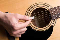 The guitarist plays the acoustic guitar close-up. Horizontal frame Stock Images