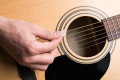 The guitarist plays the acoustic guitar close-up. Horizontal frame Stock Photos