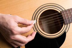 The guitarist plays the acoustic guitar close-up. Horizontal frame Stock Photography