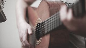 The guitarist plays an acoustic guitar. Guitarist hand and fretboard closeup. Video stock video