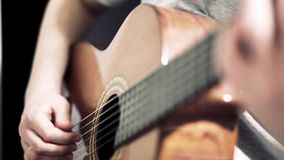 The guitarist plays an acoustic guitar. Guitarist hand and fretboard closeup. Video stock video footage