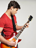 Guitarist plays on the electric guitar Royalty Free Stock Images