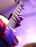 Guitarist plays electric guitar on stage Stock Photography