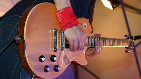 Guitarist plays electric guitar on stage Stock Images