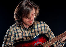Guitarist plays on a guitar Stock Photography