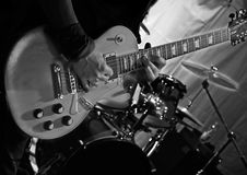 Guitarist plays guitar on stage during a live concert Royalty Free Stock Photography
