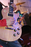 Guitarist plays guitar on stage during a live concert Royalty Free Stock Image