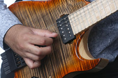 Guitarist plays guitar in the studio, close up Royalty Free Stock Photo