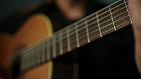 A Man`s Hand Plays An Acoustic Guitar Touches The Strings