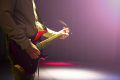 Guitarist plays. man a guitar playing Stock Image