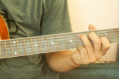 Guitarist plays with retro filter effect Stock Photos