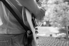 Guitarist plays during a soundcheck on stage Royalty Free Stock Image