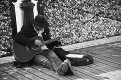 Guitarist in Pont of Arts in Paris Stock Photo