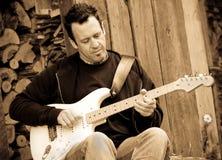 Guitarist portrait sepia closeup Royalty Free Stock Images