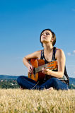 Guitarist posing outdoors Stock Image