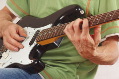 Guitarist put fingers for chords on electric guitar close up. Guitarist put fingers for chords on electric guitar closeup royalty free stock photo