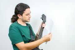 Guitarist reading Stock Photos