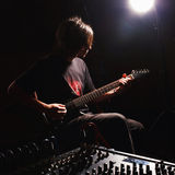 Guitarist recording and playing guitar Stock Images