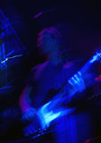 Guitarist at rock concert. Psychedelic shot of bass player at rock concert in action Stock Photo