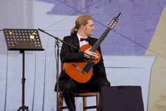 Guitarist.Roman Zorkin — the winner of Russian and International competitions. Royalty Free Stock Photo