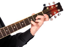Guitarist's hand. Close up of a person playing an acoustic guitar isolated on white Royalty Free Stock Image