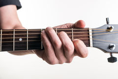 The guitarist`s hand clamps the chord C on the guitar, on a white background. Horizontal frame Royalty Free Stock Photography