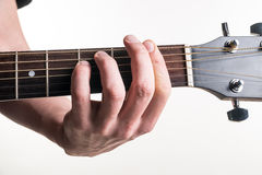 The guitarist`s hand clamps the chord Fm on the guitar, on a white background. Horizontal frame Stock Photos