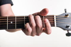 The guitarist`s hand clamps the chord G on the guitar, on a white background. Horizontal frame Stock Photography