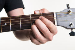 The guitarist`s hand clamps the chord A on the guitar, on a white background. Horizontal frame Royalty Free Stock Image