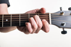 The guitarist`s hand clamps the chord Am on the guitar, on a white background. Horizontal frame Stock Photo
