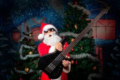 Guitarist santa Royalty Free Stock Photo