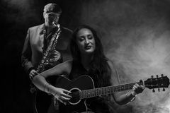 Guitarist and Saxophonist Stock Photography
