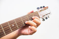 The guitarist show the D chord on the guitar. Royalty Free Stock Photos