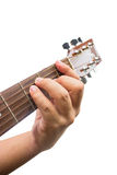 The guitarist show the F chord on the guitar. Stock Photos