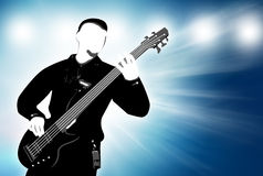 Guitarist silhouette on abstract background. Playing guitarist silhouette on abstract blue background Royalty Free Stock Photo