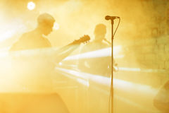 Guitarist silhouette perform on a concert stage. Abstract musical background. Music band with guitar player. Playing. Guitar and concert concept. Live music stock photos